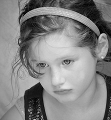 Daintily disheveled. (TazNoMore) Tags: portrait blackandwhite bw cute girl kid child little pout freckles earrings headband