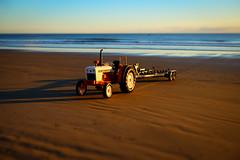 Toy tractor (lizcaldwell72) Tags: water sky hawkesbay newzealand sunrise waimaramabeach light