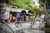 DSC_2018 (Kent MacElwee) Tags: vietnam sea asia southeastasia hoian centralvietnam oldquarter bike bicycle hat conicalhat rain