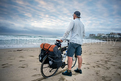 Young man with packed bicycle on beach (JFJacobszPhotography) Tags: overland elements bicycle discover long young weight gear explore ready packspanniers hybrid beach road supplies journey intrepid experience far stamina go single white sidewalk twenties loaded bags tent back travel time alive sunrise one weather side sea earlymorning ride man adventure ocean distance open packed overlanding cloudy front luggage early frame life gearedup