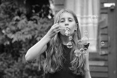 (Pam 73) Tags: portrait bw girl garden hair blackwhite daughter shed bubbles blow