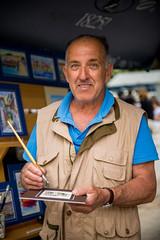 portrait of an artist (Sam Scholes) Tags: travel vacation portrait man europe artist forsale market fineart croatia painter split hr streetvendor splitskodalmatinskažupanija