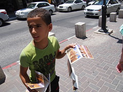 Kid selling postcards!
