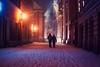 blustery winter evening (ewitsoe) Tags: snow snowing couple winter evening poznan poland ewitsoe nikond80 35mm street city golembia staryryenk oldtown market polska season storm windy