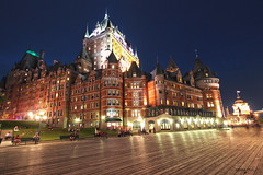 Fairmont Le Château Frontenac - Québec City (Québec, Canada) (Andrea Moscato) Tags: andreamoscato canada america night notte notturno dark darkness light shadow cielo city città cityscape hotel castello castle frontenac château wood legno walk walkway promenade old ancient view vivid architecture blue reflection people town tower albergo yellow red
