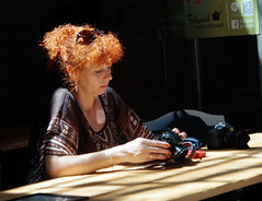 It's the Result that Counts (Hindrik S) Tags: lady light red hair camera checking result glasses sunglasses candid street straat streetphotography straatfotografie sun sunlight control looking sonyphotographing sony sonyalpha slta57 α57 a57 tamron tamronspaf1750mmf28xrdiiildasphericalif tamron1750 1750 licht ljocht f28 30mm 1250 iso100 2015 strjitfotografy streetphoto amount strasenfotografie strase
