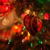 Seasonal Joy II (Anne Worner) Tags: anneworner bend bendy blur bokeh closeup closeupfilter lensbaby lights macro macromondays orbs ornament square sweet35 tree heart glass fragile bokehorbs selfie warm red reflection seasonal christmas
