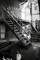 Ups And Downs (Wєirdlig) Tags: abandoned exploring exploration urbex rurex decay asbestos creepy abstract eclectic vacant photography destroyed urban ruins trespass trespassing haunted desolate architecture building house home colorado indoor interior blackandwhite monochrome bw factory mill industrial canisters stairs stairwell stair vandalism tag tags sugar destruction