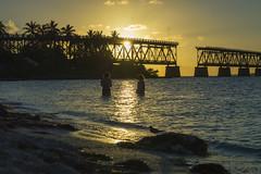 Bahia Honda Beach Girls (aaronrhawkins) Tags: swimming florida keys vacation silhouette bridge railroad palm ocean swim wade sand twilight evening kellie jessica aaronhawkins bahiahonda sunset