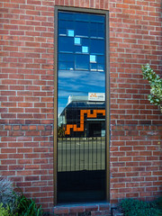 Misguided (Steve Taylor (Photography)) Tags: route adley art architecture design logo sign building railing fence window blue orange brick newzealand nz southisland canterbury christchurch cbd city plant bush foliage shape diagonal square reflection sky
