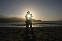 Perfect Sunset on our Honeymoon (GRPhotog) Tags: ocean sunset sun love beach silhouette canon hawaii bay kiss honeymoon tokina kauai sunburst hanalei 1116 70d