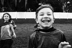 DSC_9293-Edit-Edit (markstrohmjr) Tags: child children boy girl junge mädchen cape outside blackandwhite bw face run nikon nikon7100 whitefence grass