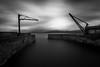 Lade pier (strupert) Tags: nikon bigstopper lee badweather grotty storm rain norway trondheim seascape mono longexposure bnw crane pier lade