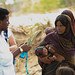 """Mohammed a health extension worker supplying a water treatment powder """"wuha agar'' to villagers"""