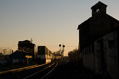 11-4711 (George Hamlin) Tags: virginia berryville railroad freight train norfolk southern western ns 203 intermodal containers double stack sunset glint buildings grain elevator color position light signals photo decor george hamlin photography