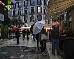 Drinking in the rain c (Joaquín Mª Crespo) Tags: callejeo calle ciudad color street streetphoto leica leicaq málaga lluvia bares paseantes paraguas umbrella rain