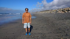 Earth Tones and Blue (Chris Hunkeler) Tags: beach rocky boardshorts