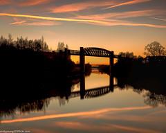 Latchford Locks (6 of 8) (andyyoung37) Tags: latchfordlocks manchestershipcanal reflections uk warrington bridge cheshire oldrailwaybridge orangesky sunset