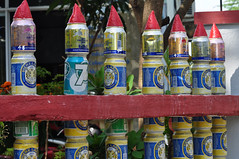 Beer-can fence (Roving I) Tags: fences beercans tins originality design bierelarue redbull 7up drinks empties hoian vietnam humour whimsy