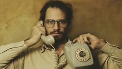 Monocromo (J.J.Evan) Tags: man wall shirt paper beard pared glasses phone telephone tube teléfono numbers chico papel tones tubo hombre números barba anteojos camisa tonos