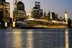 New York City (mudpig) Tags: newyorkcity longexposure reflection skyline night skyscraper sunrise river dawn golden boat ship cityscape manhattan worldtradecenter batterypark license cruiseship hudsonriver hdr horizonte gettyimages wallst nuevayork fido oceanliner orizzonte lighttrail  royaltyfree  cidadedenovayork mudpig stevekelley    linhadohorizonte lignedhorizon ufukizgisi 1worldtrade      thnhphnewyork   kakilangit   oneworldtrade lavilledenewyork stevenkelley chntri  sylwetkanatlenieba  licensenow    latarlangit