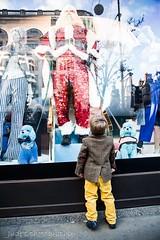 Enjoying the fantasy (judethedude73) Tags: candid window shop festive urban street christmas boy