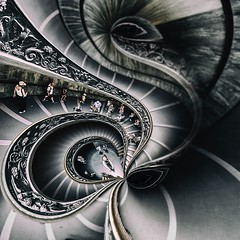 Bramante Staircase Reimagined  -  Vatican, Rome (ShanePix) Tags: conceptual blackandwhite monochrome pattern geometric abstract texture black background architecture building surreal indoor symmetry rome vatican bramantestaircase spiral stairs people blur focus italy kafka hat navona piazza piazzanavona street streetphotography