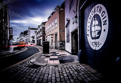 Plymouth Gin [ Explore ] (NikNak Allen) Tags: plymouth devon barbican street cobbles road lights xmas christmas door buildings architecture sky clouds car lighttrail longexposure