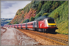 Virgin 43068, Teignmouth (Jason 87030) Tags: virgin virmin hst red powercar sea wall teignmouth devon seaside holiday 2001 september shot print 35mm 125 xc crosscountry plymouth penzance ibntercity highspeedtrain| buffer sunny rails track 4306 class43