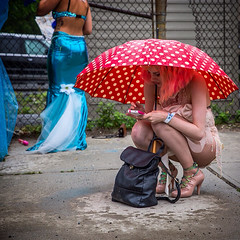 338 (mookie.nyc) Tags: nyc woman sexy wet beautiful rain brooklyn umbrella coneyisland phone dry parade polkadots coverage mermaid mermaidparade stayingdry michahsapersteinphotography mookienyc mermaidparade2015