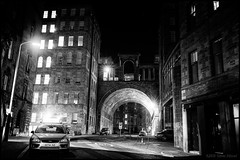 Walking on the dark side of the evening (OR_U) Tags: 2016 oru uk scotland edinburgh noir filmnoir bw blackandwhite blackwhite schwarzweiss photoshopped dark city street night nightphotography buildings nightlights cars