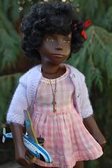 Where Do the Children Play (Emily1957) Tags: dolls doll toys toy sashadolls sashadoll vinyl gingham airplane light naturallight nikond40 nikon blackdoll child childhood toyairplane redribbon