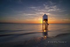 The Lighthouse (pixellesley) Tags: lighthouse sunset seascape sky sea sand sundown water ocean waves ripples reflection starburst clouds nightfall stilts landscape lesleygooding