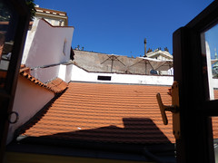 Roof of restaurant, 2016 Aug 27 (Dunnock_D) Tags: czechia czechrepublic prague nerudova vegansprague restaurant roof rooftop blue sky window tiles malástrana lessertown