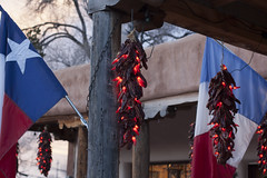 Paris, Texas, & Ristras (ajahwasabeenut) Tags: santafe southwest canyonroad colorful artgallery art lights ristra chile flags sunset