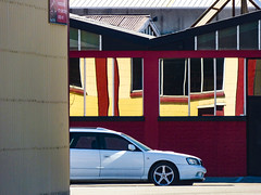 Time to Upgrade Windows (Steve Taylor (Photography)) Tags: architecture building window wall roof black brown mauve purple red yellow metal iron newzealand nz southisland canterbury christchurch corrugated distorted reflection car auto automobile