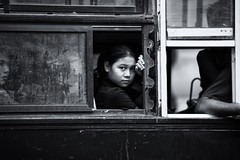 Girl on the bus~ Myanmar (~mimo~) Tags: streetphotography street yangon blackandwhite eyecontact look window bus girl portrait asia burma documentary mimokhairphotography myanmar travel