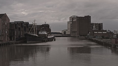 High water (moggsterb) Tags: urban brown mill river industrial desaturated hull muddy trawler hightide museumquarter arcticcorsair riverhull drypoolbridge rankbuilding