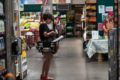 Shopper at Rainbow Grocery (cooli_#1) Tags: california street food men girl photography photo rainbow nikon women san francisco walks shoot outdoor district bart 85mm mexican mission trucks grocery nikkor 18 tough d3