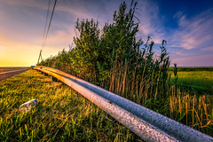 Litter Knows No Bounds (gregmolyneux) Tags: landscape litter powerlines roads guardrails goldenhour leadinglines cedarrundockroad