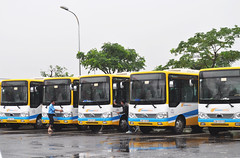 Cleaning team (Roving I) Tags: cleaners cleaning hoses buses publictransport puddles rain weather team danang danabus depots vietnam action service