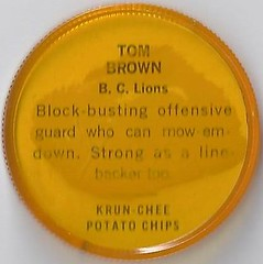 1963 Krun-Chee / Nalley's Potato Chips CFL Plastic Football Coin (golden yellow cap) - TOM BROWN #150-KC (Hall of Fame 1984) (British Columbia Lions / Canadian Football League) (upgraded coin) (Treasures from the Past) Tags: 1963 cfl nalleys coins potatochips hunters krunchee humptydumpty nocompanyname nobrand canadianfootballleague nobrandbilingual bilingual football cap disc lownumber highnumber shortprint footballcoins footballcaps vintage tombrown bclions britishcolumbia hof halloffame