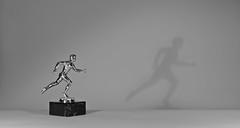 Silver man (Lichtbursche) Tags: läufer statue pokal silber mann schatten schwarzweis runner cup silver man shadow blackandwhite monochrome mecklenburgvorpommern deutschland