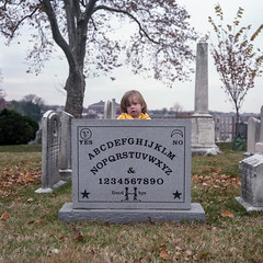 (patrickjoust) Tags: greenmountcemetery elijahbond grave ouijaboard baltimore maryland mamiyac330s sekor80mmf28 fujicolorpro400h twin lens reflex tlr 120 6x6 medium format fuji c41 color negative film manual focus analog mechanical patrick joust patrickjoust md usa us united states north america estados unidos autaut kid boy greenmount cemetery tombstone tomb cloudy gray sky trees