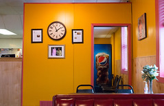 (Jeremy Whiting) Tags: yellow clock wall red saturation bright colors pepsi blue indoors low light michigan ypsi ypsilanti restaurant cuppys window booth chair reflection warm canon digital plant wide angle
