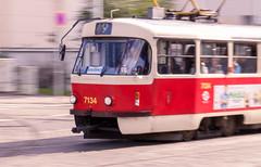 Public transportation in Prague (Jan Malkovsky) Tags: red people train wagon drive europe publictransportation prague transport 9 tram electricity czechrepublic panning comercial tramvaj 810 bookeh