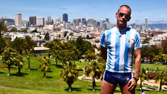 Carl at Dolores Park, San Francisco (Blue Rave) Tags: skyline bloke building buildings bulge city dude guy legs male mate men nature people sexy shorts stud thighs park sanfrancisco sf downtown blueshorts sunglasses thecolorblue athletic colors colours color colour meninshorts guysinshorts bulging 2010 wideangle blue panorama panoramic splitshorts face adidas adidasshorts stripes california ca