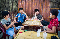 Chinese Chess (Joni Kantonen) Tags: street travel people man men travelling ice beer bar evening pub day vietnamese tea drink smoke chinese chess streetphotography guys firework smoking vietnam streetphoto local hanoi liberation ninhbinh travelphotography
