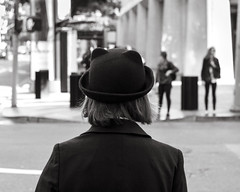 Urban Street Life 8x10 (ocDeluxe) Tags: sanfrancisco california bear people urban blackandwhite bw usa black blur blancoynegro girl monochrome hat fashion fauna cat canon blackwhite downtown bokeh unique candid or streetphotography kitty style streetlife ears 8x10 bowlerhat streetphoto citystreets blackbear beyourself t3i sidewalkstories scattidistrada