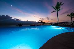 Poolside sunset (Northwest dad) Tags: sunset tree pool mexico four nikon seasons palm resort punta mita f28 d800 1424mm